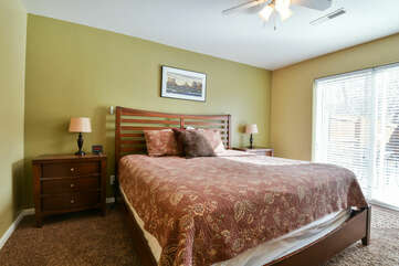Large Bed, Nightstands, Ceiling Fan, Table Lamps, and Windows.