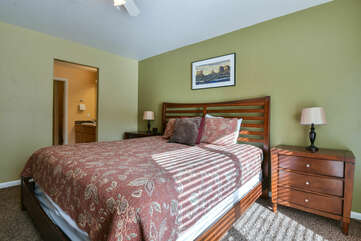 Bedroom with Large Bed, Nightstands, and Table Lamps.