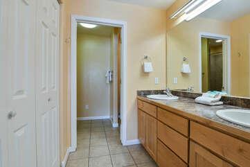 Double Vanity Sink, Mirror, and Closet Doors.
