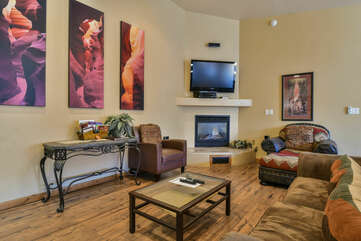 Arm Chairs, Sofa, Console Table, Coffee Table, Fireplace, and TV.