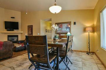 Dining Set, Pendant Lamp, Floor Lamp, Sofa, Fireplace, and TV.