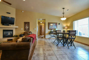 Sofa, Fireplace, TV, Dining Set, and Window.