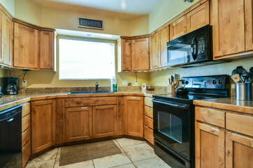 Kitchen Sink, Cabinets, Dishwasher, Stove, and Microwave