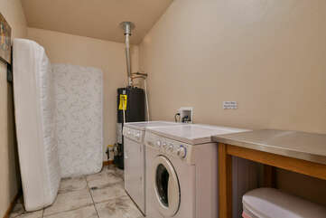 Laundry Room with Washer and Dryer and Two Twin Mattresses.