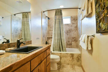 Shower-Tub Combo, Toilet, and Single Vanity Sink with Mirror.