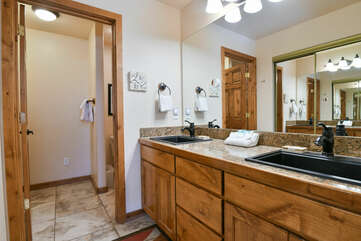 Double Vanity Sink, Mirror, Lamps, and Towels.