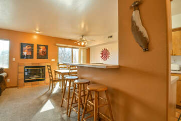 dining area with 3 bar stools and a fireplace