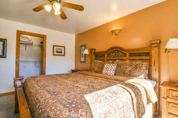 master bedroom with a king bed and a closet