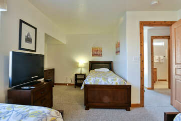 bedroom with twin beds and a TV