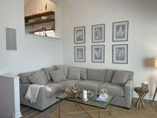 A large sectional sofa awaits your family gathering.