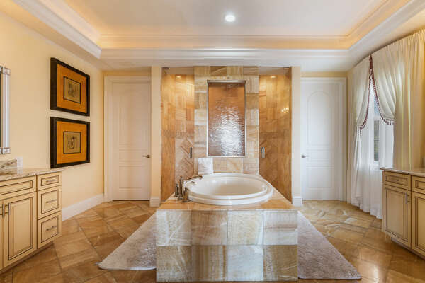 Beautiful ensuite bathroom with vanity, walk-in shower, and garden tub