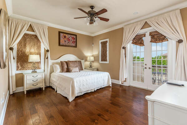 The lavish master suite features a comfortable king bed