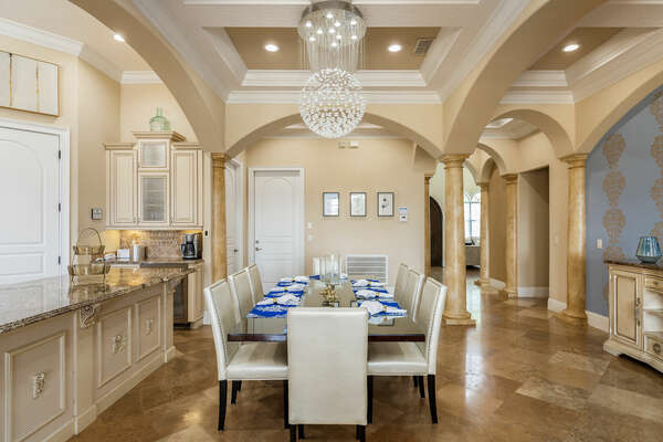 Host a family-style dinner at the formal dining table with seating for up to 8