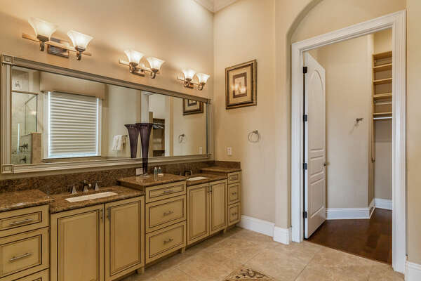 Ensuite bathroom with a walk-in closet to store your luggage