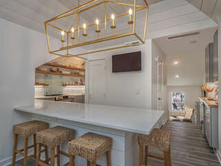 Absolutely top notch kitchen/dining area with wall mounted HDTV
