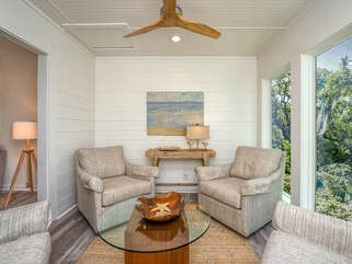 The sun room invites you to enjoy your favorite beverage for conversation, watching the abundance of wildlife outside, and the spectacular views.