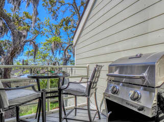 The sunroom has access to an open deck with incredible marsh views, table seating and propane grill.