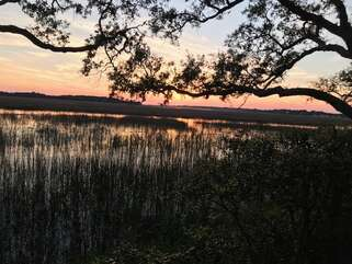 Welcome to 1704 Live Oak Park in Shelter Cove Villas!  Beautiful water views of sunset over the marsh and tidal creek from the villa