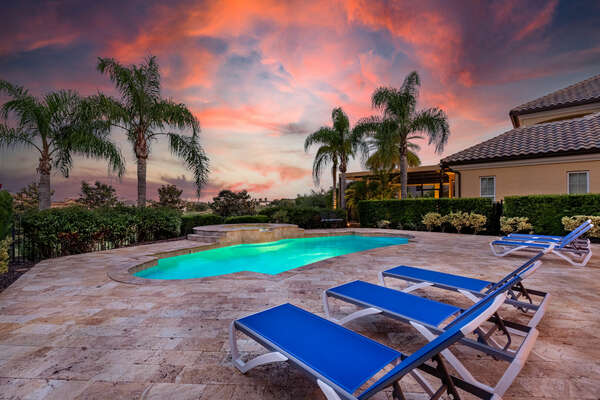 Grab a drink, head to the pool and watch the sun set over this amazing view