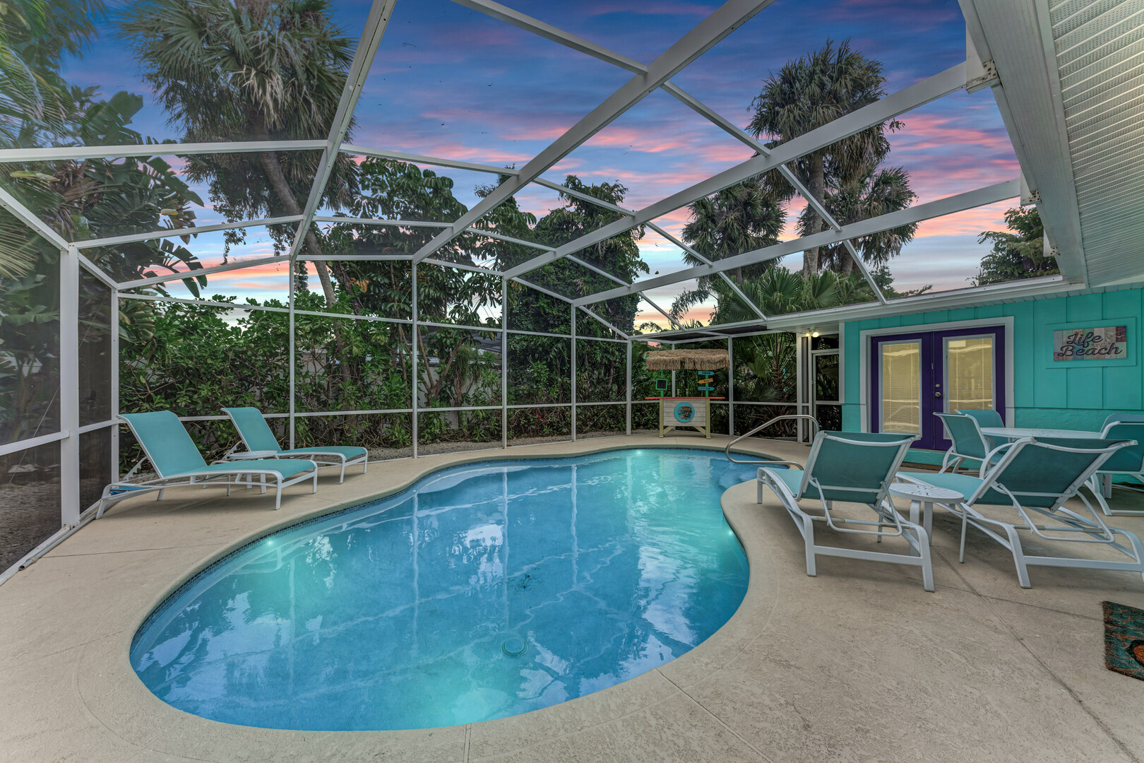Barefoot Bungalow pool area at sunset