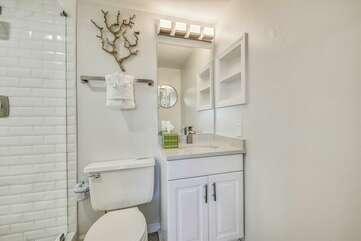 Main level bathroom + tiled shower