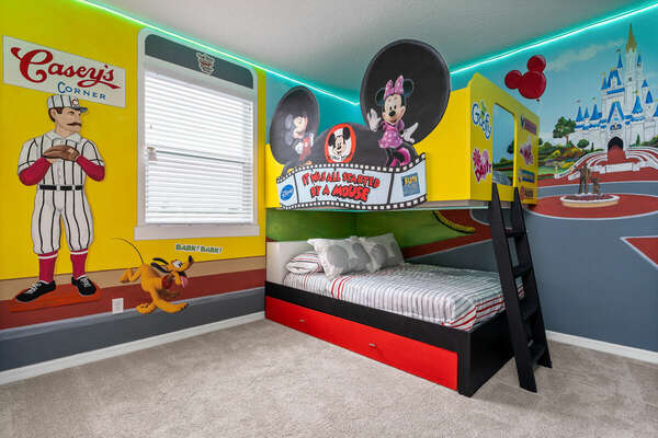 Trundle bed pulls out to sleep a third child.