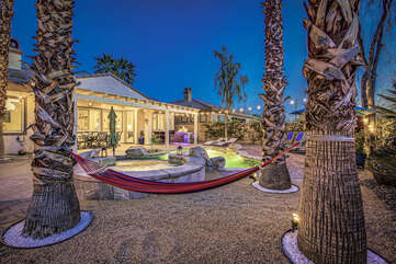 Watch the stars while relaxing in the hammock nestled between the palm trees,