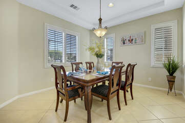 The casual dining area features a dining table with seating for 6.