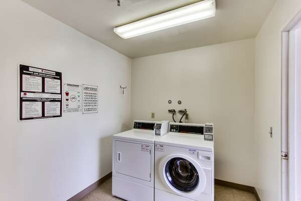 Communal coin-operated washer and dryer located on each floor of the Riviera Villas