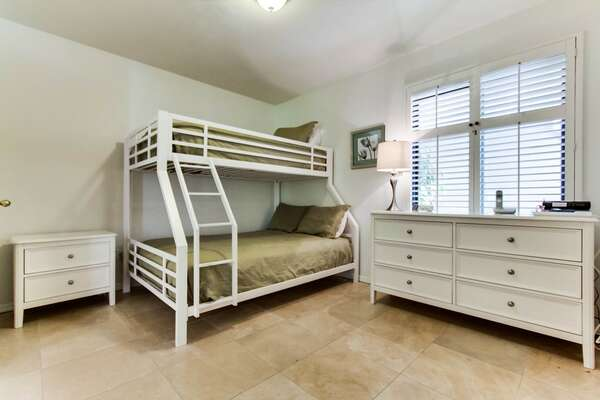 Guest bedroom with 1 full and 1 single size bunk bed set, dresser drawer and closet space, adjustable blinds on windows