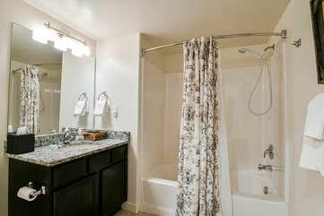 Hall bathroom with bathtub and sink