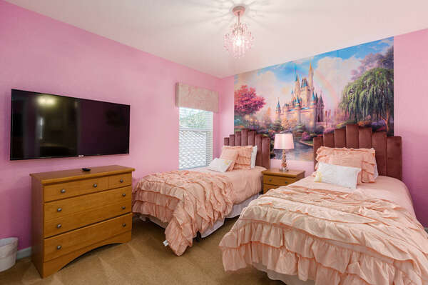 A kids bedroom featuring two twin beds with SMART TV
