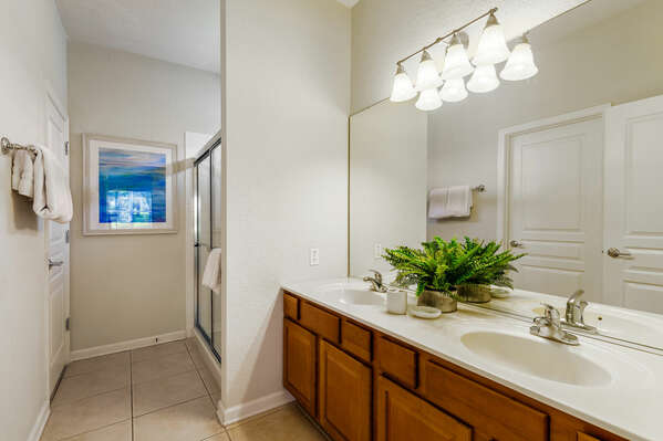 The ensuite bathroom has a dual vanity and walk-in show