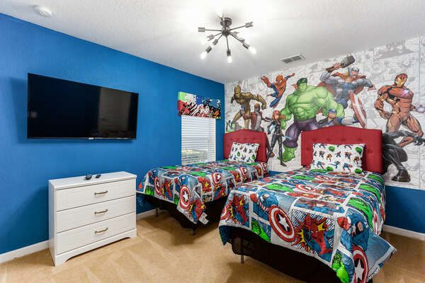 Superheros will love the second twin bedroom featuring a SMART TV