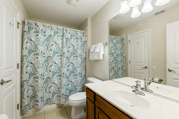 Bathroom connected to superhero themed bedroom