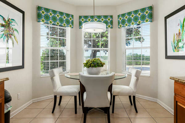 A kitchen nook with a beautiful view
