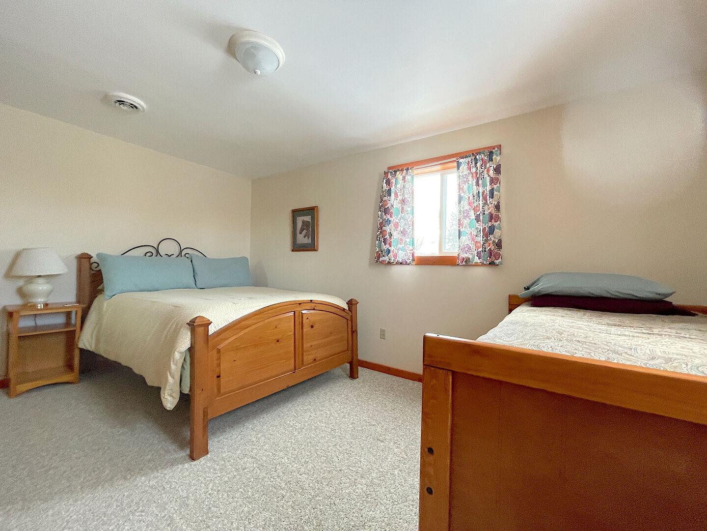 View of Bedroom 2 Queen & Twin beds