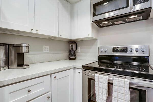 Kitchen Amenities Include Keurig Machine, Standard Coffee Maker,  Ninja Blender and Stainless Steel Appliances - Second Floor