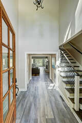 Grand entry, 2 story foyer, modern stairs, light and airy feel.