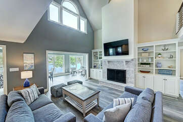 Living room - all TV's are smart with Spectrum cable - catch a game or views of the lake!