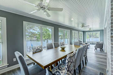 Dining table in the Sun Room - seating for 8-10. Just steps from the kitchen.