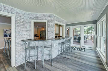 Private back deck, off the sunroom only steps from the kitchen