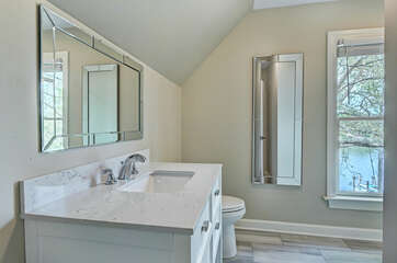 Double queen - attached full bath, walk in shower.