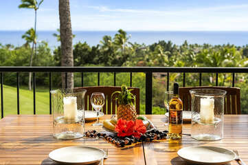 Outdoor Dining Table Set with Plates and Wine Overlooking the Ocean