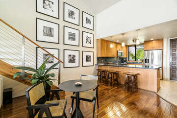 Professionally Remodeled Living Area with Wood Floors and Ample Seating