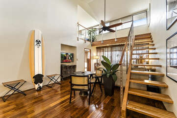 Surfboard and View of the Loft and Staircase