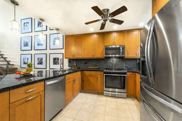 Fully Equipped and Newly Remodeled Kitchen with Black Counter Tops