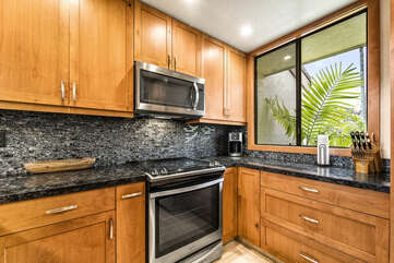 Full Kitchen with Stainless Steel Appliances and Wood Cabinetry at Kona Country Club Villa