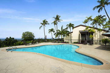 Pool Surrounded by Palm Trees with Ocean Views at Kona Country Club Villa