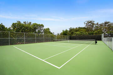 Green Tennis Court Surrounded by Trees at Country Club Villas